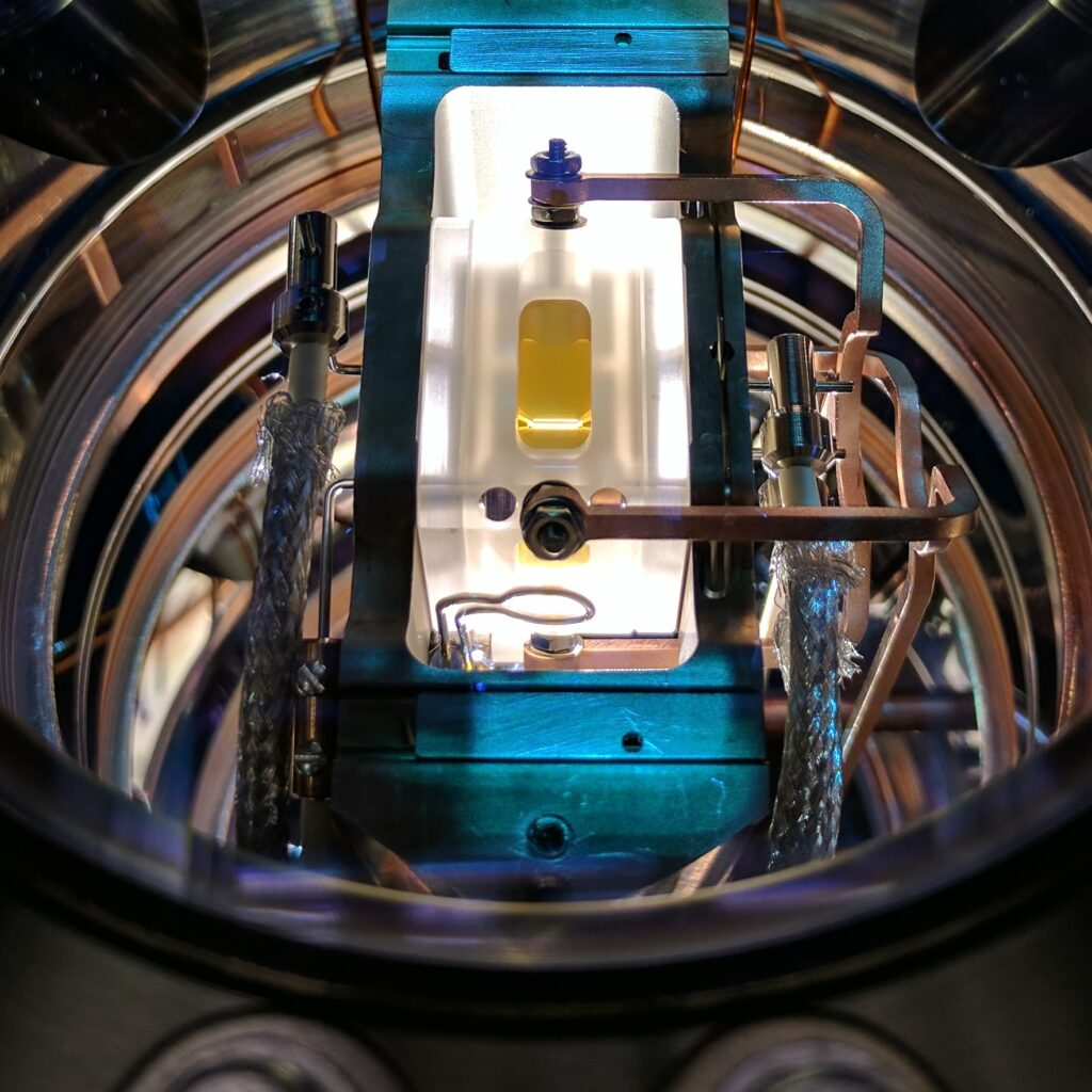 A ion trap apparatus inside its vacuum chamber